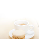 Colorful macaroons with espresso coffee. Over white wood table Stock Image