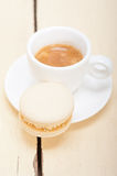 Colorful macaroons with espresso coffee. Over white wood table Royalty Free Stock Images