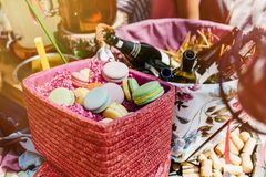 Colorful macaroons and flowers on wooden table. Sweet macarons i royalty free stock photo
