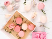 Colorful macaroons, Colorful french dessert, traditional french colorful macarons in a rows in a box Stock Image