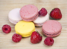 Colorful macaroons with fruit Royalty Free Stock Photography