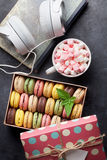Colorful macaroons in a gift box and headphones Royalty Free Stock Photos