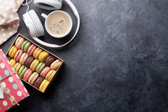 Colorful macaroons in a gift box and headphones Stock Photo