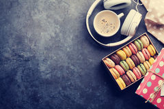 Colorful macaroons in a gift box and headphones Stock Photography