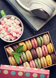 Colorful macaroons in a gift box and headphones Royalty Free Stock Photo