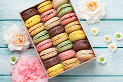 Colorful macaroons in a gift box and roses Royalty Free Stock Photography
