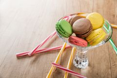 Colorful macarons in a glass in cafe Stock Photography