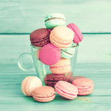 Colorful macaroons in a glass cup Stock Photography