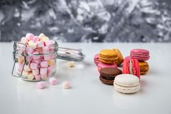 Colorful macaroons with marshmallows stock photo