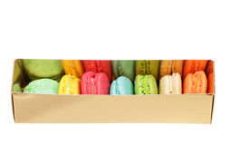 Colorful macaroons the golden box Royalty Free Stock Photos