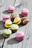 Colorful macaroons on gray wood Stock Photography