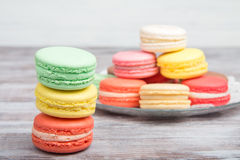 Colorful macaroons on gray wooden background Stock Images