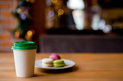 Paper coffee cup to go in the cafe royalty free stock photo