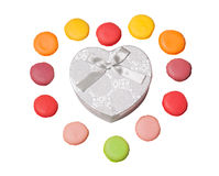 Colorful macaroons with heart shape gift box on white background Royalty Free Stock Photo