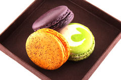 Colorful macaroons isolated in brown box Royalty Free Stock Photo