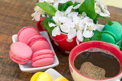 Colorful macaroons - macaron and black coffee Stock Images