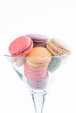 Colorful macaroons in a Martini glass Stock Images