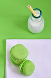 Colorful macaroons and milk in a bottle Royalty Free Stock Image