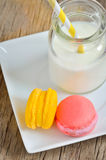 Colorful macaroons and milk Royalty Free Stock Image