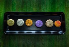 Free Colorful Macaroons On Black Plate Royalty Free Stock Photo - 145526675