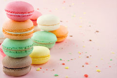 Colorful macaroons on pink background Royalty Free Stock Photos