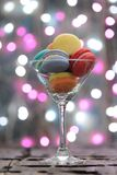 Colorful macaroons place in a champagne glass Stock Image