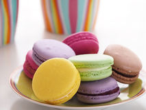 Colorful macaroons on plate Royalty Free Stock Photography