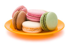 Colorful macaroons on plate Royalty Free Stock Image
