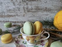 Colorful macaroons. Macaroons in pretty colors on a white wooden background Royalty Free Stock Images
