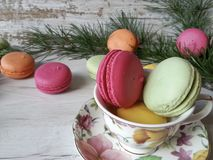 Colorful macaroons. Macaroons in pretty colors on a white wooden background Stock Photography