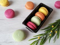 Colorful macaroons. Macaroons in pretty colors on a white wooden background Stock Images