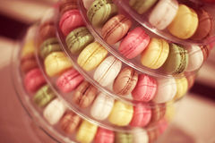 Colorful macaroons on rounded plate Stock Photos