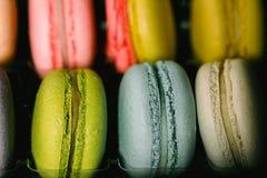 Colorful macaroons set on black background. Closeup food photo. Macro photography Stock Image