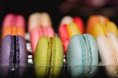Colorful macaroons set on black background. Closeup food photo. Macro photography Stock Photo