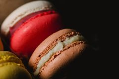 Colorful macaroons set on black background. Closeup food photo. Macro photography Royalty Free Stock Images