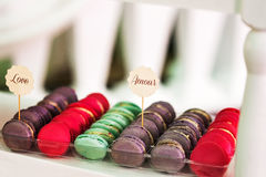 Colorful macaroons stacked on display. At an event Stock Photography