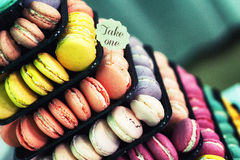 Colorful macaroons stacked on display. Filmic hipster looking colorful macaroons stacked on display Stock Photo
