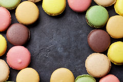 Colorful macaroons on stone table. Sweet macarons Royalty Free Stock Images