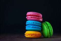Colorful macaroons tower close-up on black background. Royalty Free Stock Photography