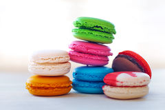Colorful macaroons tower close-up on whitebackground. Stock Photography