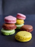 Colorful macaroons variety closeup on dark background. A french sweet delicacy. Dessert Royalty Free Stock Image