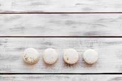 Colorful macaroons on a white desks royalty free stock photo