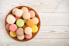 Colorful macaroons on white vintage table, with copy space royalty free stock image
