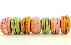 Colorful macaroons on white wood table Royalty Free Stock Photo