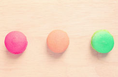 Colorful macaroons on wood with retro filter effect Royalty Free Stock Photos