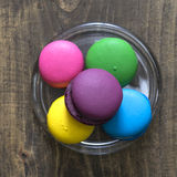 Colorful macaroons  on wooden background Royalty Free Stock Photos
