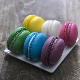 Colorful macaroons  on wooden background Stock Images