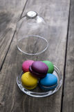 Colorful macaroons  on wooden background Royalty Free Stock Photography