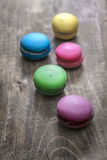 Colorful macaroons  on wooden background Stock Image