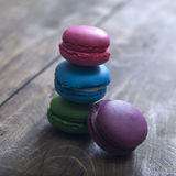 Colorful macaroons  on wooden background Stock Photography